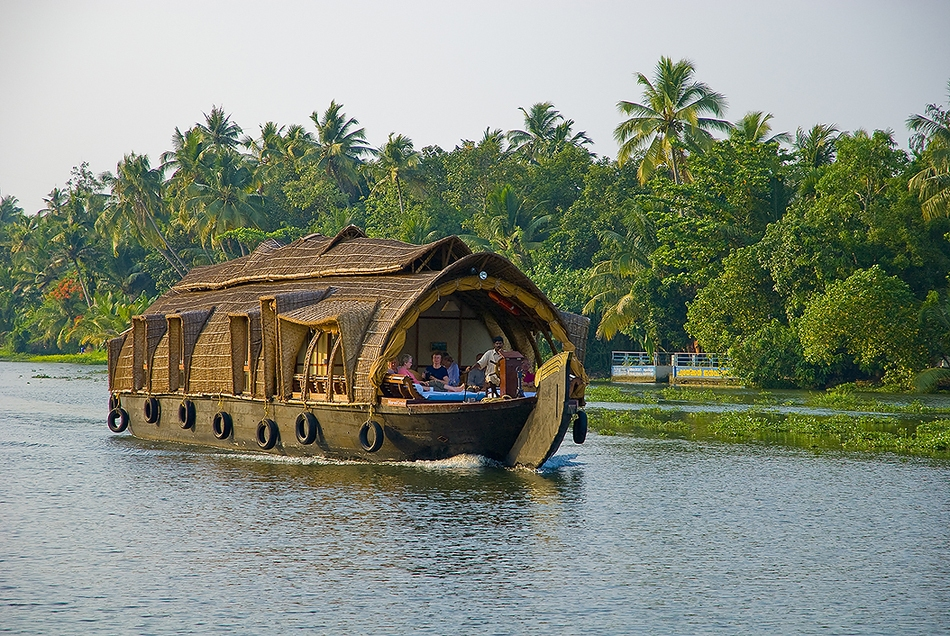 Luxury Houseboats ply the backwater canals all around the area of Alleppy in Kerala, India.