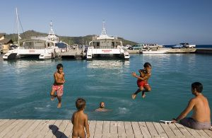 Kids jumping off the dock in Bora Bora