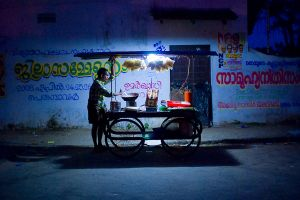 A food vendor waits for customers in the Fort Cochin