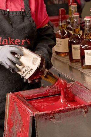 Wax sealing of Makers Mark bottles.