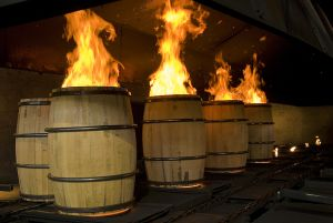 Charring barrels at the cooperage gives bourbon flavor.
