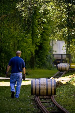 Rolling barrels to the shipping dock at Woodford Reserve.