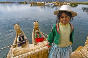 A young girl and her parents on Lake Titicaca
