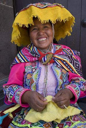 A woman in outside the cathedral in Cuzco