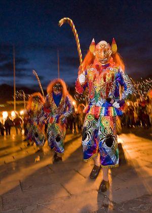 Masked dancers at the Virgin of the Door celebration