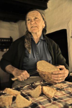 Etelka slices her bread